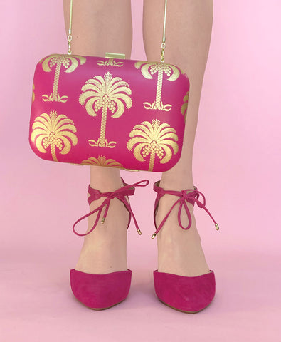 Hot pink nappa clutch bag with gold foil palm tree print