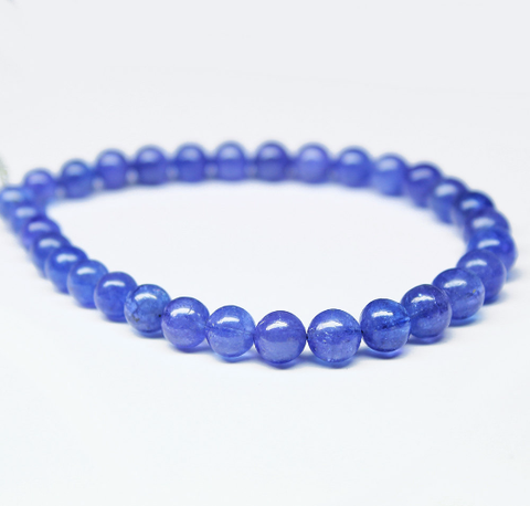 Bead, Tanzanite (natural), 6.5mm smooth round, A grade, Mohs hardness 6, Sold per 1 pair SKU1692 - Jewels Exports - 1