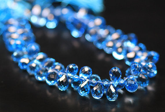Top AAA Swiss Blue Topaz Micro Faceted Briolette Tear Drop Beads, 6mm, 8 inches, SKU7931AB - Jewels Exports - 1