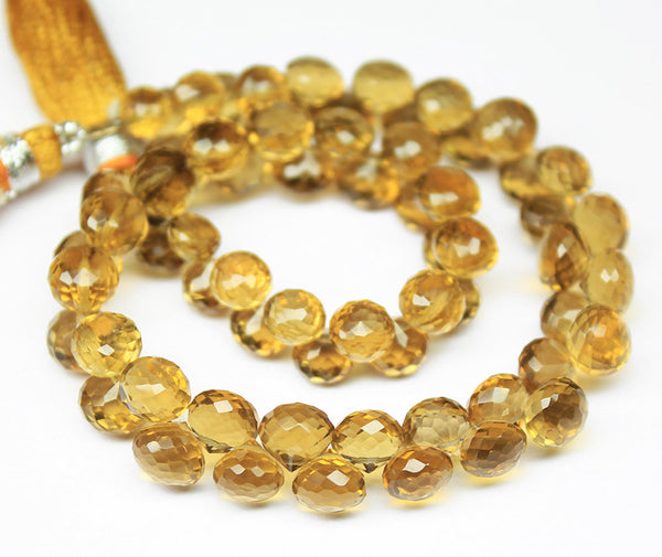 Beads, Beer quartz (natural), 5-6mm hand-cut faceted onion drops, A grade, Mohs hardness 7. Sold per 8-inches SKU5390/J - Jewels Exports