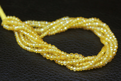 Beads, Yellow Zircon (natural), 3mm faceted roundel beads, A grade, Mohs hardness 7. Sold per 16-inch strand, SKU/M - Jewels Exports - 1