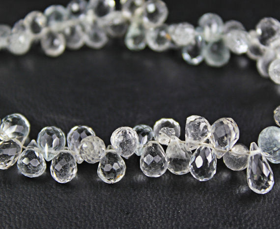 White Topaz Faceted Tear Drop Briolette Beads, 11 beads pair, 6.5mm, SKU6897A - Jewels Exports