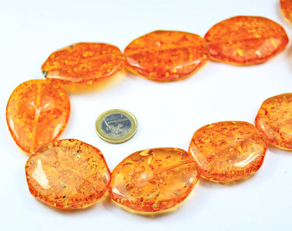 Synthetic Amber Smooth Flat Oval Beads Strand, 17 inches, 27-32mm, SKU695A - Jewels Exports