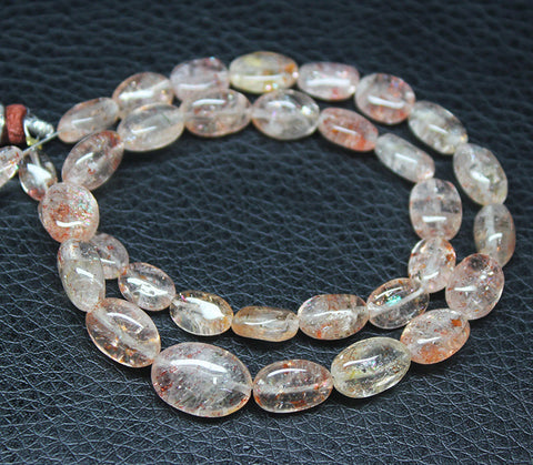 Sunstone Smooth Polished Oval Beads Strand, 7-13mm, 14 inches, SKU3803A - Jewels Exports