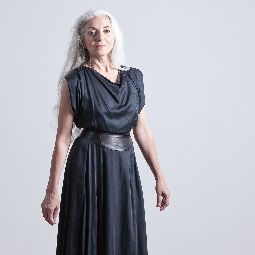 Model Alex B in phannatiq black bamboo florence dress with grey background