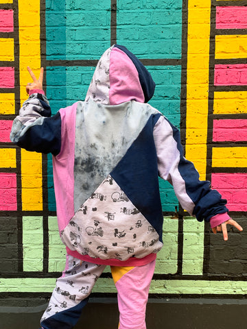 E17 hoddie in bubblegum colourway Hooded Top made from random bits and bobs from our studio Inspired by all the colourful street art in our neighbourhood Walthamstow This hoodie is made to from bits of fabric left over in the studio which has been hand dyed with left over dyes from other projects so very much a zero waste project  It has a front pocket, hood, looooong sleeves with rib cuffs and some of the panels are printed in our Fly Tipping print