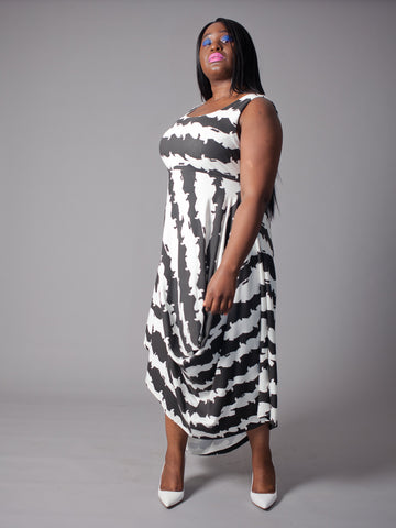 PENELOPE DRESS Draped Empire cut Dress made from Organic Cotton and Bamboo Jersey and can be worn as a maternity dress too, thanks to some cunning pattern cutting and its empire line, high enough to sit above a bump, with a voluminous skirt which cascades elegantly off any figure in cat stripe print