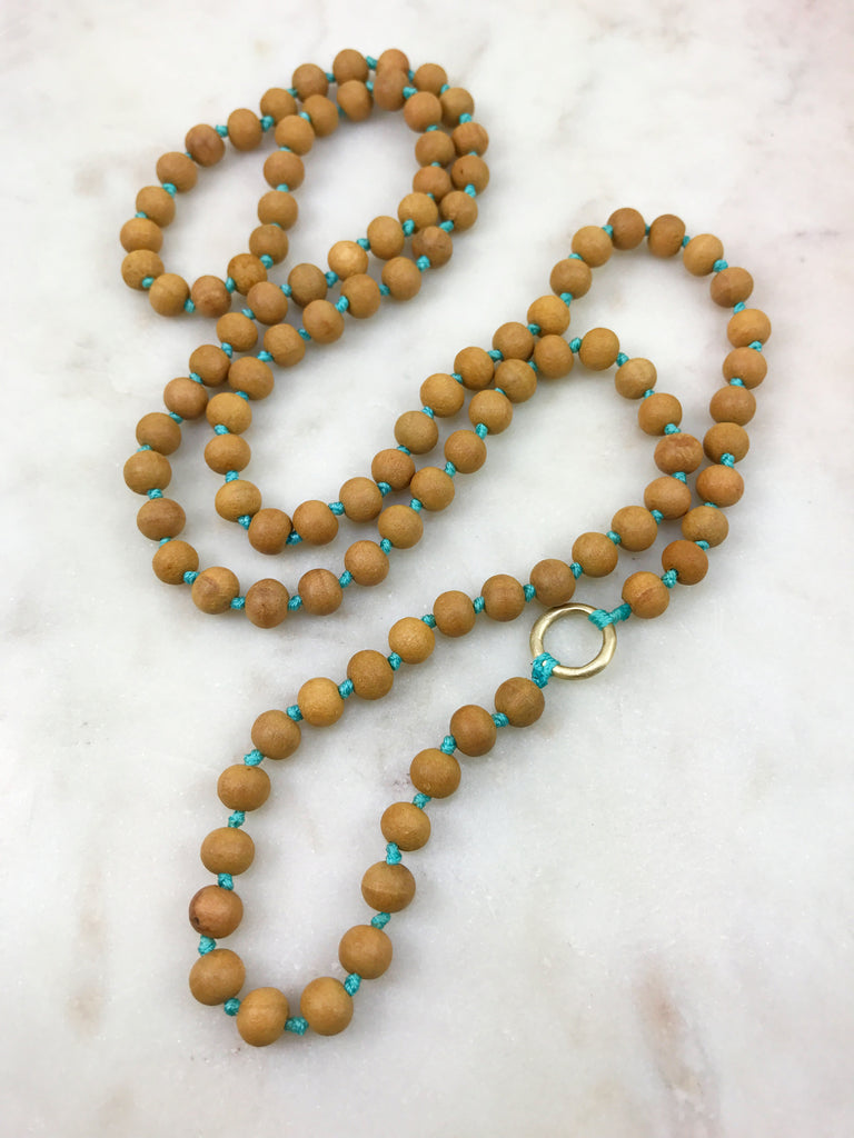 Sandalwood Mala with Gold Ring