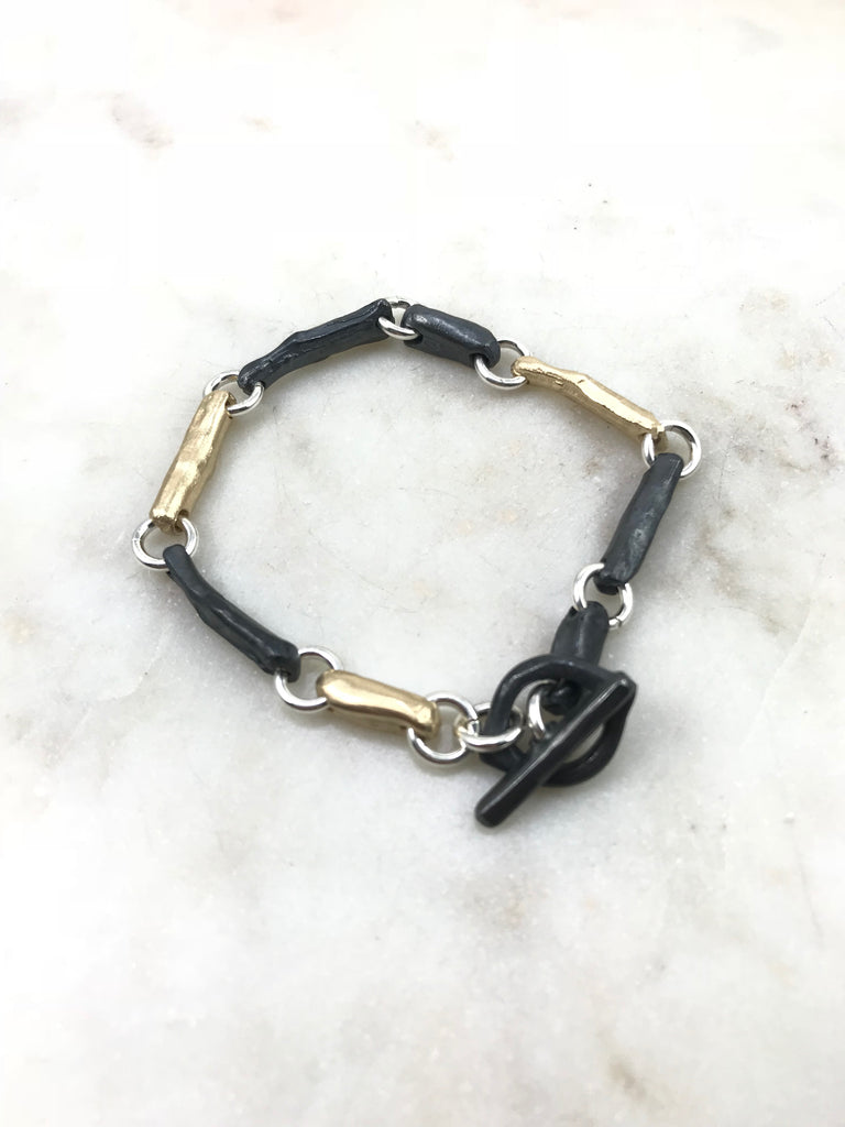 Bones & branches bracelet in silver & gold