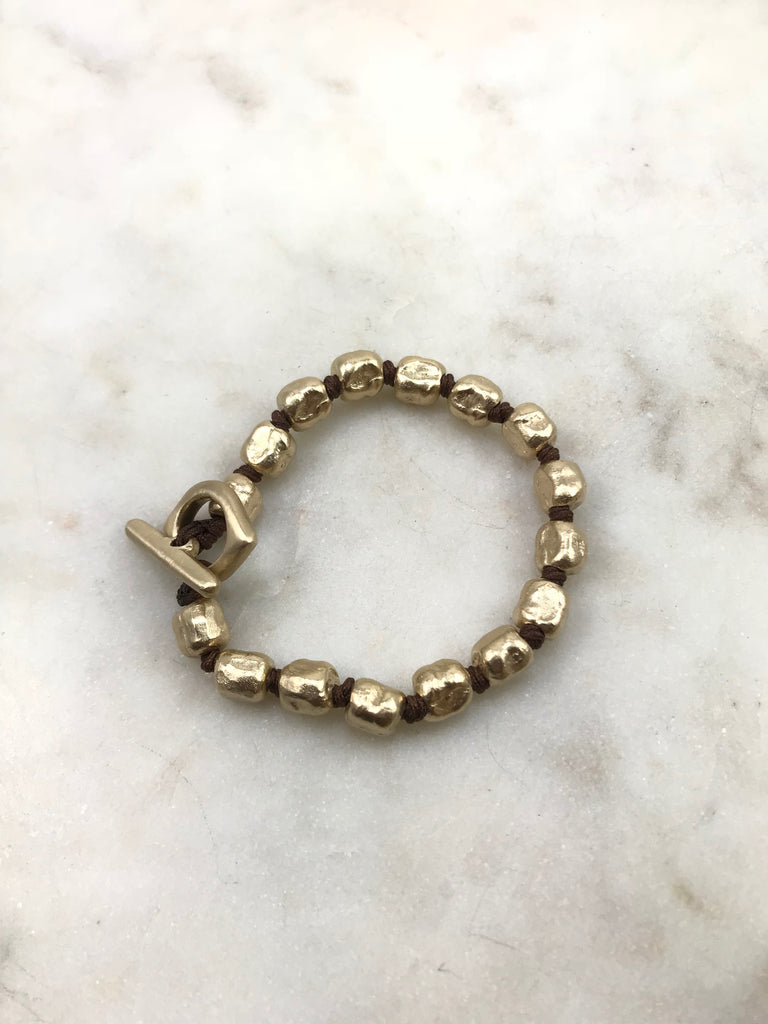 Gold nugget end evil-eye bracelet