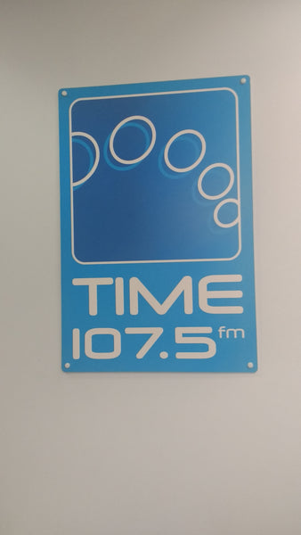 Time 107.5 sign