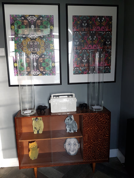 Art posters and vintage hand decorated cabinet