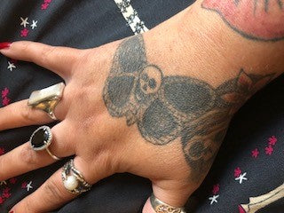 Emma butterfly skull tattoo