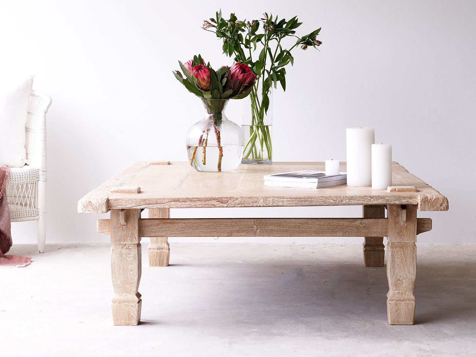 /></div><p></p><b>The Beauty of Old Teak</b> <br><br>Coffee tables from our Nomad Village range are wholly dedicated to the natural beauty of old teak wood. We love the warmth and richness of old solid teak - the way it deepens as it ages and takes on a patina as the years pass by. It feels like satin, smooth and soft to the touch. Each piece is unique and will add character and style to your living room. <br><br>We spend time carefully working with the wood, hand-crafting it to highlight the intricacies in the grain and natural knots and marks that make every piece unique. The beauty of natural materials lies in its peculiarities and imperfections. Variations in the wood grain, colour, knots and other natural characteristics are inherent. These are far from flaws, but are an intrinsic part of its character. We believe that these authentic imperfections contribute to the charm of our products.  <br><br>No veneered MDF has been used on this product. All the wood used for this dining table top is solid Teak timber. This makes the product far stronger, heavier and of a much higher quality. Solid teak timber is relatively easy to repair should it get chipped or damaged unlike a veneered surface. The whitewash also helps conceal marks and stains, making your dining table look great for many years.<p></p><div class=