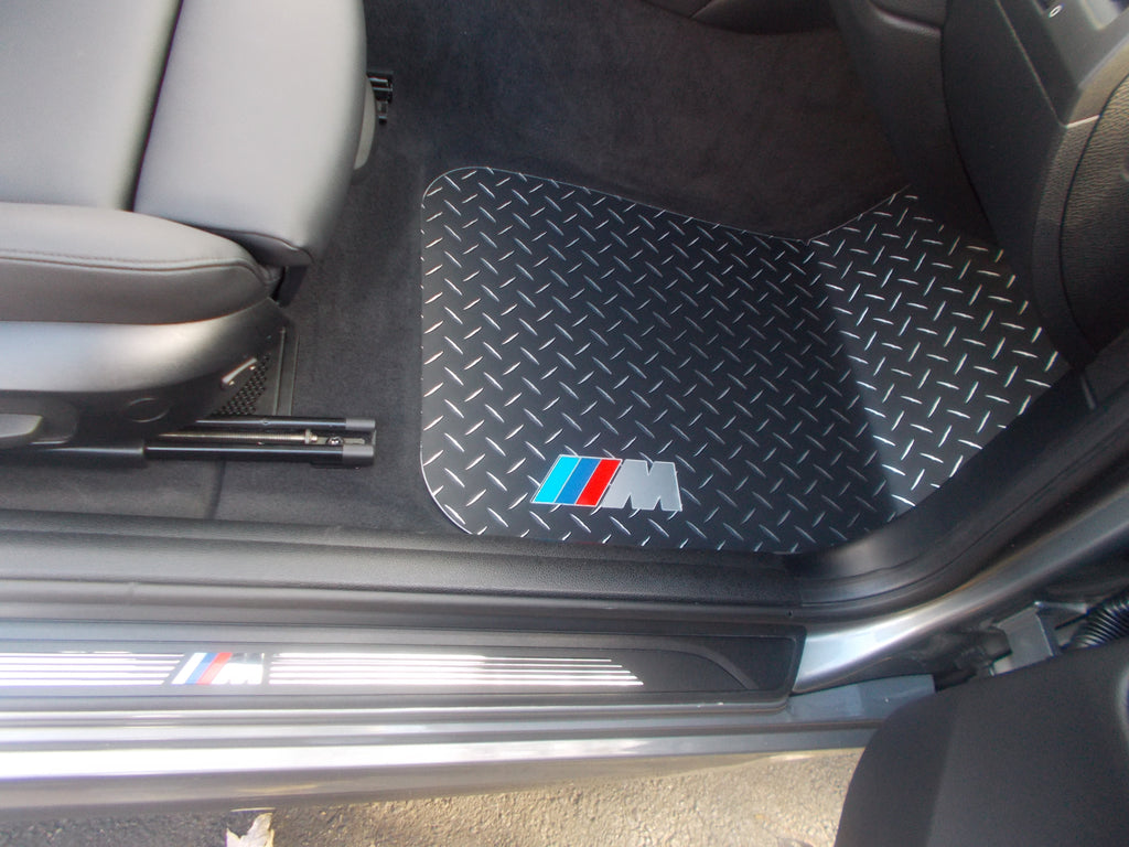 BMW 1 series 04 - 11  Black Metal diamond floor mats.  Custom shaped Front and rear + foot