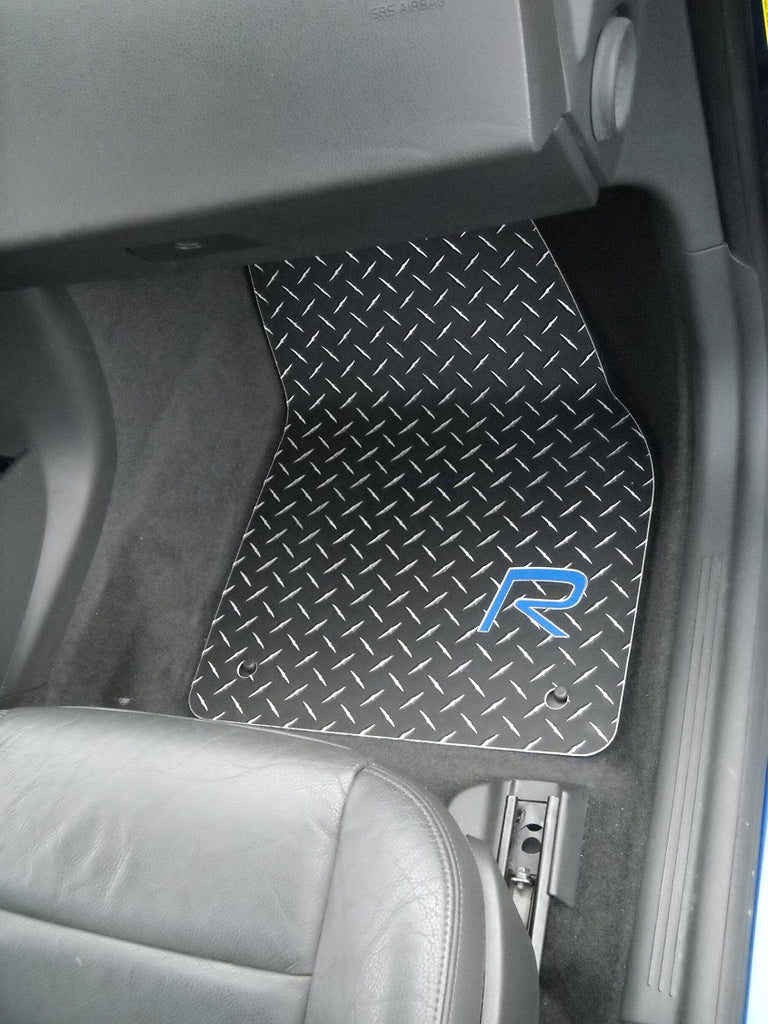 Volvo C30 R Line  05-15 Aluminum floor mats.  Black powder coated metal treads