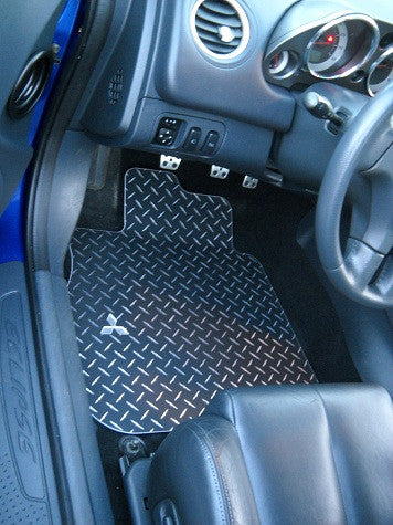 Eclipse 06 - up   Aluminum floor mats.  Black with exposed Metal diamond design