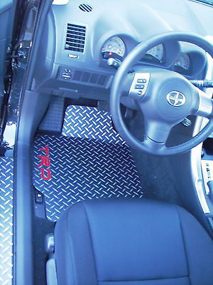 tC 04-10 TRD   Black With Exposed METAL silver diamond floor mats.  FRONT pair