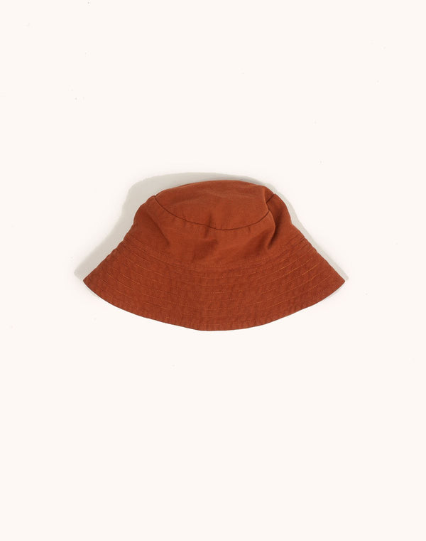 Noble Sun Hat in Cinnamon color with strings tucked under
