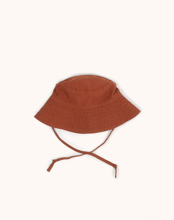 Noble Sun Hat in Cinnamon color with strings hanging low