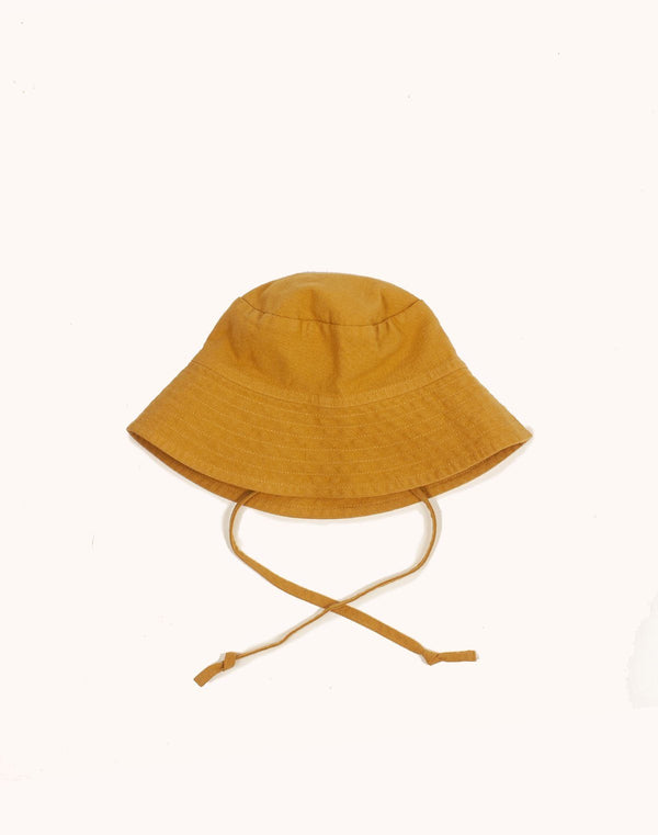 Noble Sun Hat in Turmeric color with strings hanging low