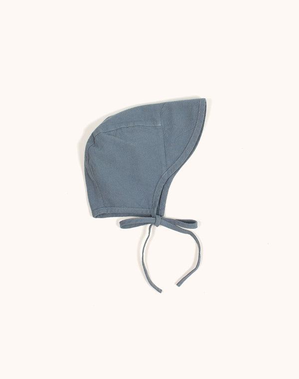 Noble Brimmed Bonnet in Moon Blue tied with a bow