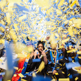 Times Square Confetti launches blue and yellow slowfall confetti over Pace grads