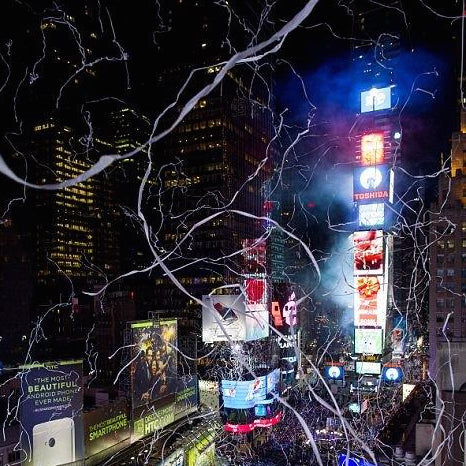 Times Square Confetti's White Tissue X-Streamers create Spiderman's webs over New York City.