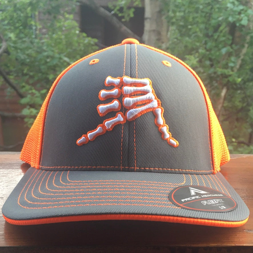AkS Bones Trucker hat in Graphite & Neon Orange