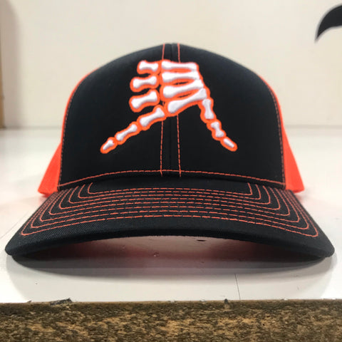 AkS Bones Snap-Back Trucker hat in Black & Neon Orange