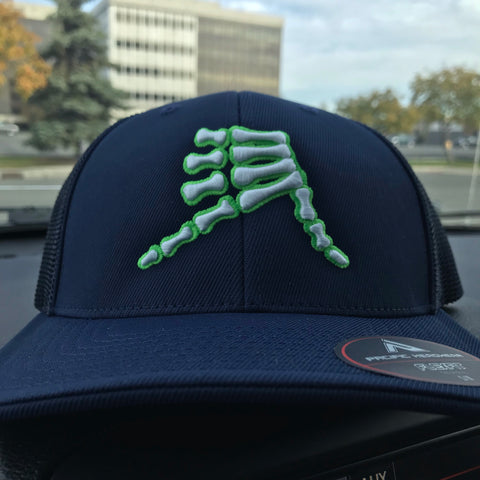 AkS Bones Trucker Hat in Navy with Neon Green