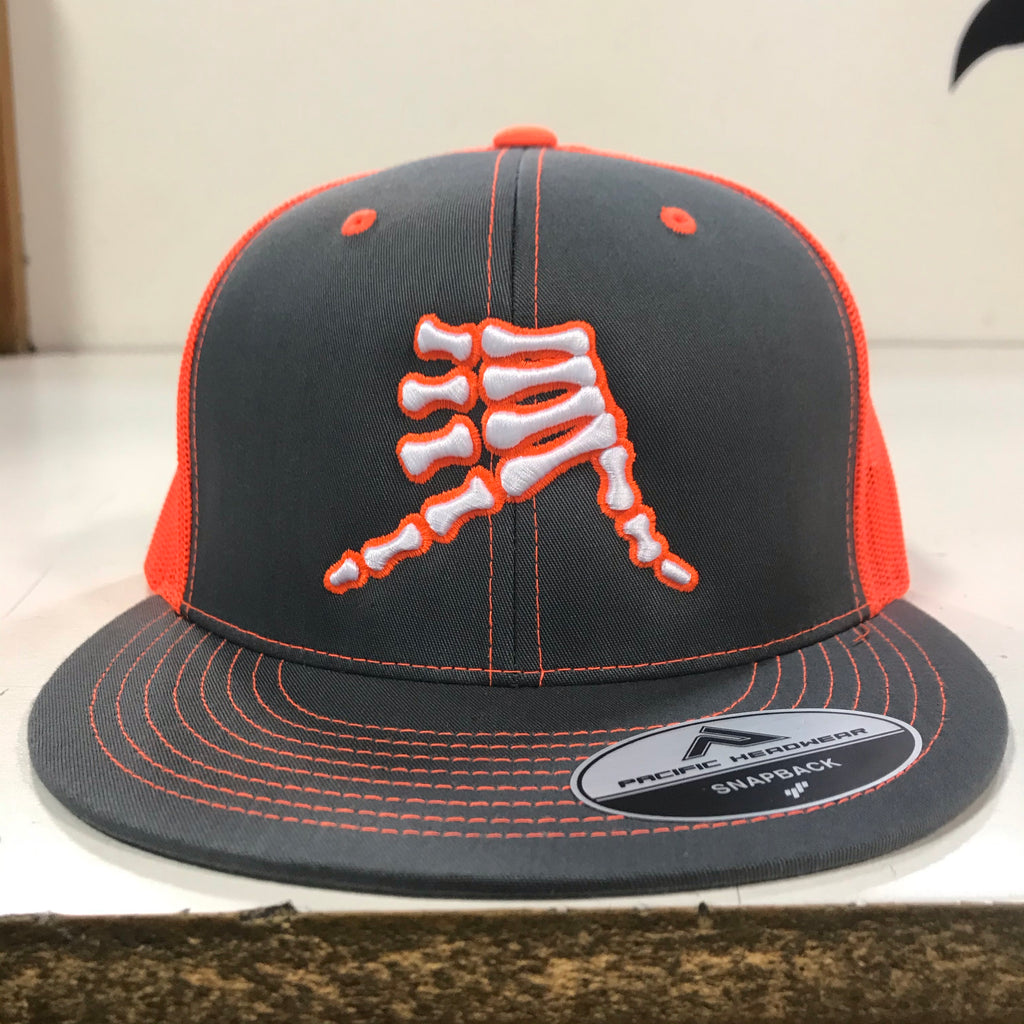 AkS Bones Snap-Back Flatbill Trucker hat in Graphite & Neon Orange
