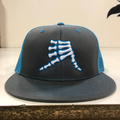 AkS Bones Snap-Back Flatbill Trucker hat in Graphite & Neon Blue