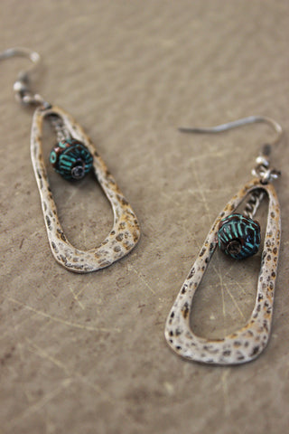 Hammered Open Oval And Dangling Ball Earring
