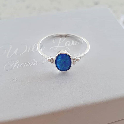 Silver blue pacific blue synthetic opal ring