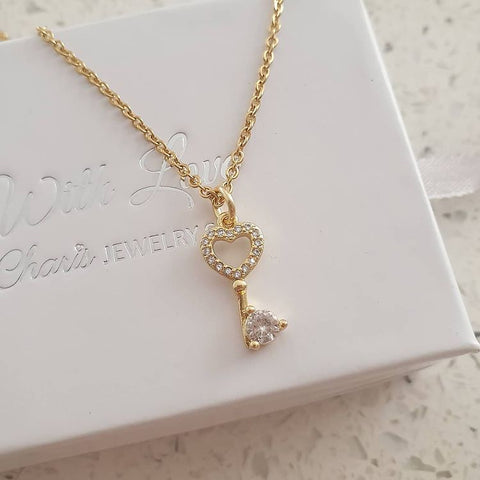 SS2-CB0212621 - Gold Stainless Steel Cubic Zirconia Key Necklace