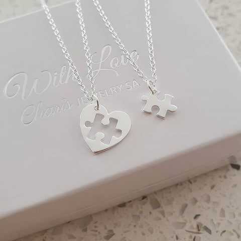 Silver puzzle piece necklace set
