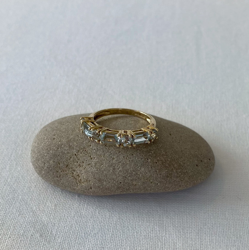 Aquamarine half eternity solid gold ring