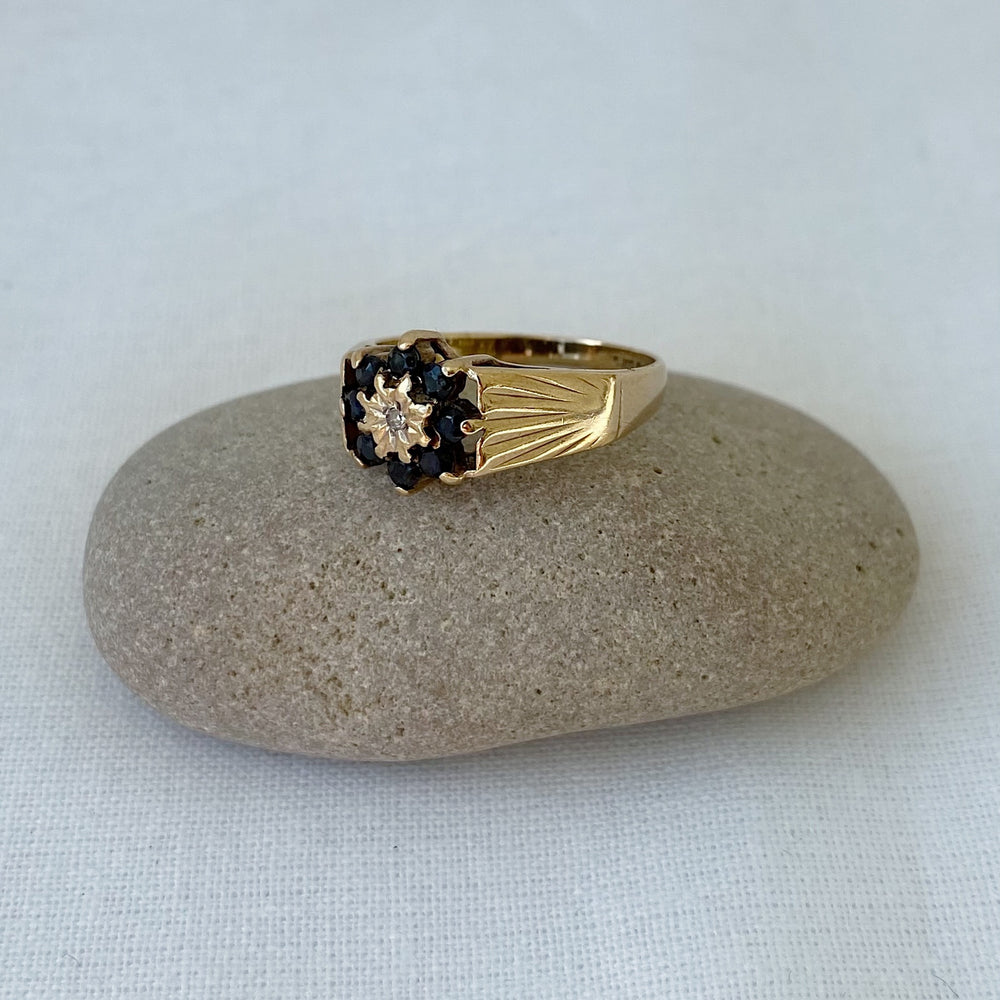 Sapphire and diamond cluster wide band solid gold ring