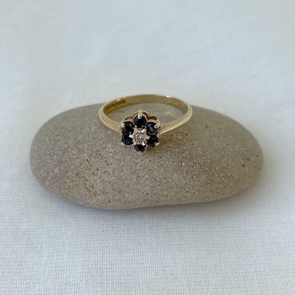 Sapphire and diamond small flower cluster solid gold ring