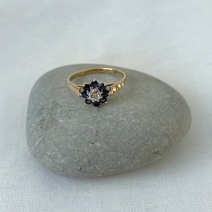 Sapphire and diamond flower cluster solid gold ring