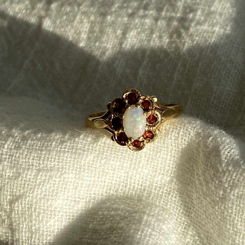 Opal and tiny garnets solid gold ring