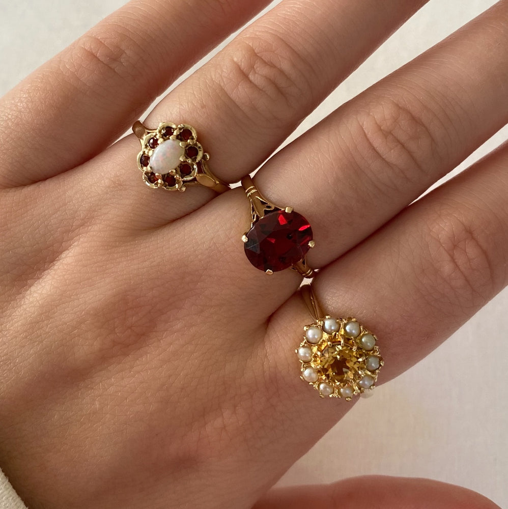Large oval garnet solid gold ring