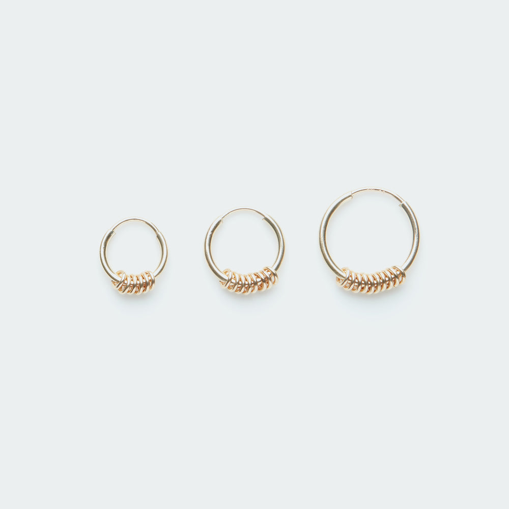 Gold hoop earring with tiny rings