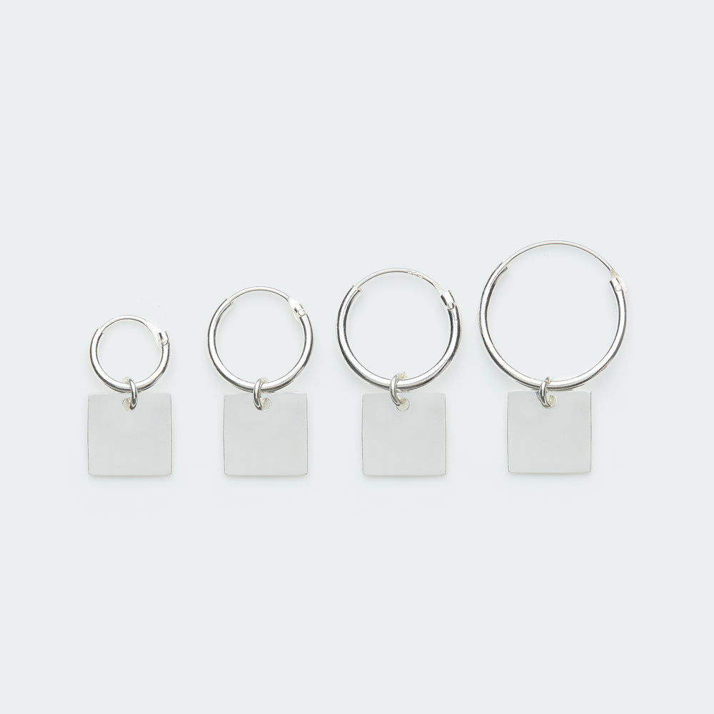Silver hoop earring with square pendant