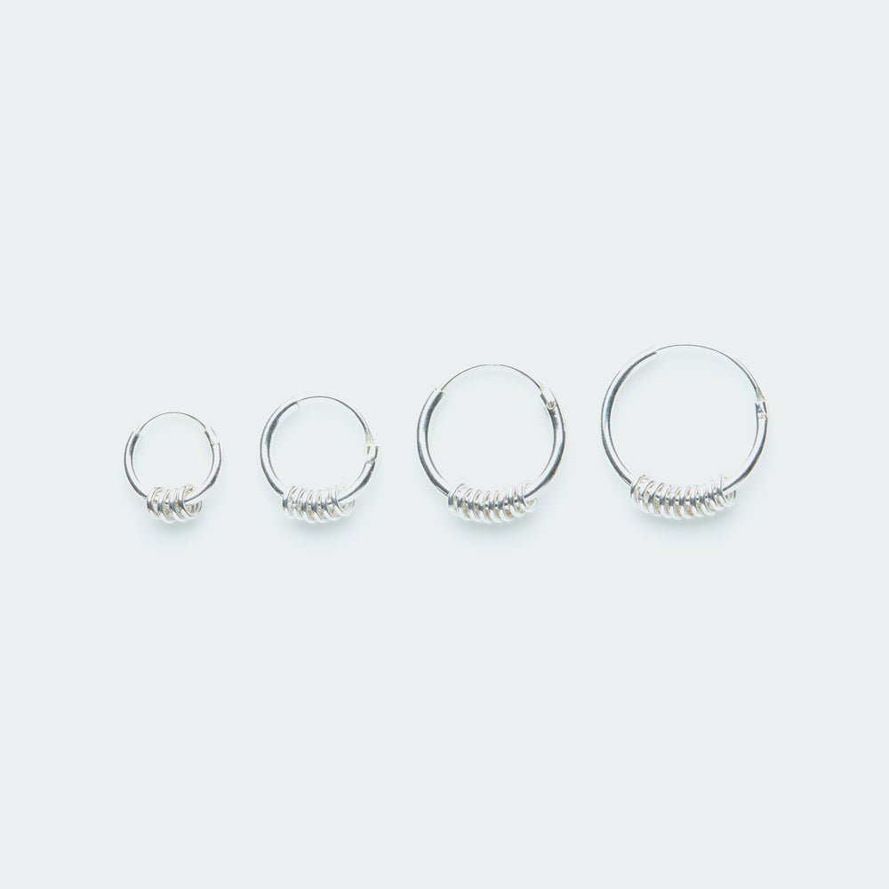 Silver hoop earring with tiny rings