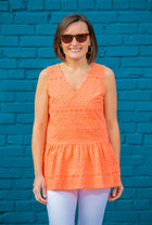 Eyelet Sleeveless Peplum Top in Coral