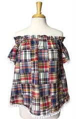 Ruffled Betty Top in Navy Patchwork Plaid with White Poms