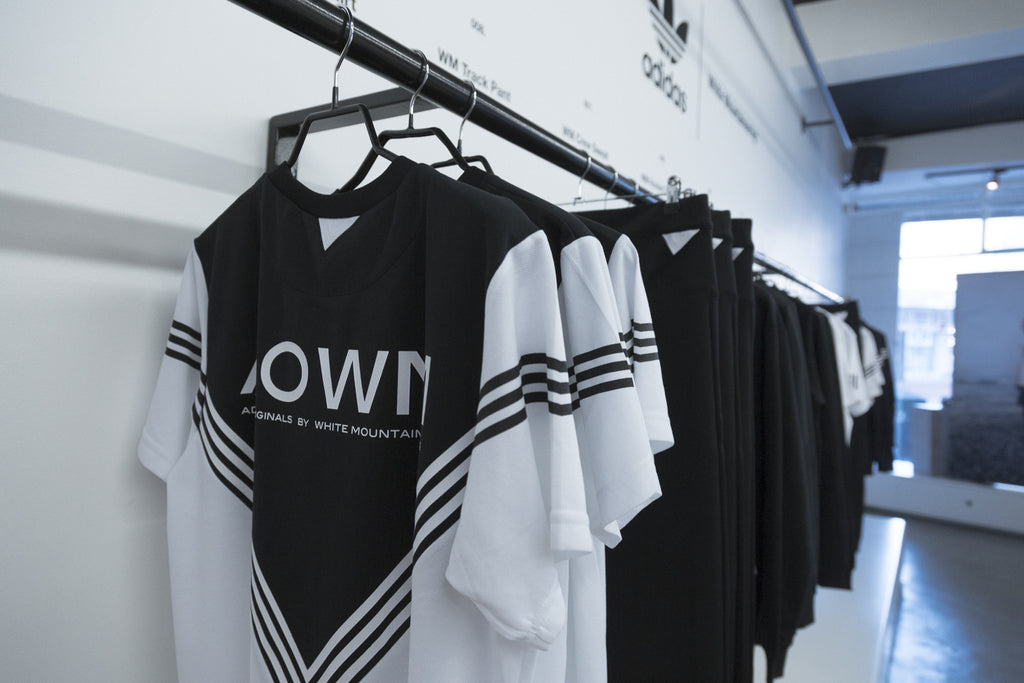 A Store adidas x White Mountaineering launch - clothing rail