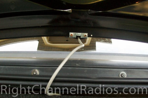 Trunk Lip Cb Mount installed on the bottom of a car trunk
